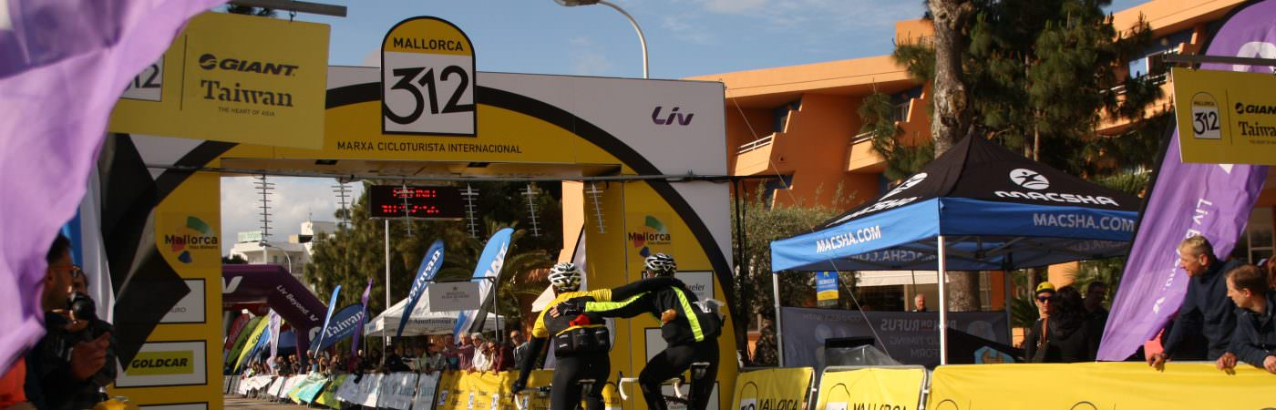2 Sunvelo Cyclists Crossing the line at the Mallorca 312