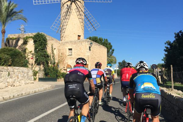 Sunvelo cyclists going past a windmill restaurant