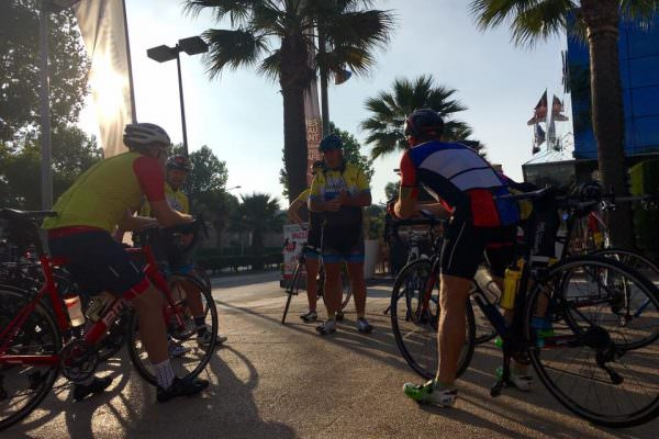 Group of cyclists contemplating their route in Majorca